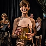 Anne Hathaway celebrated her February 2013 Oscar win with a glass of Champagne.