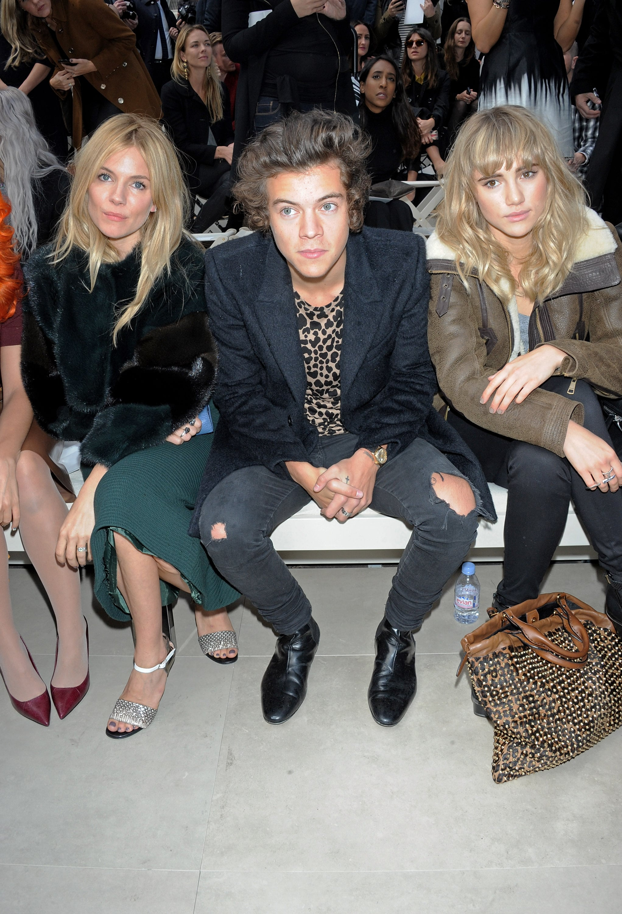 Harry Styles sat with Sienna Miller and Suki Waterhouse at the Burberry Prorsum show during London Fashion Week.