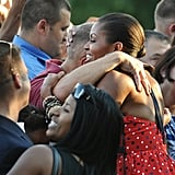 A patriotic Michelle hugged a guest at the 2010 festivities.