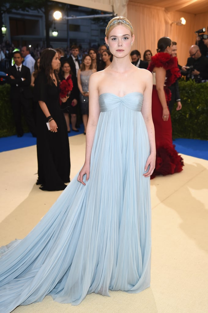 Elle Fanning in a Blue Gown as . . .