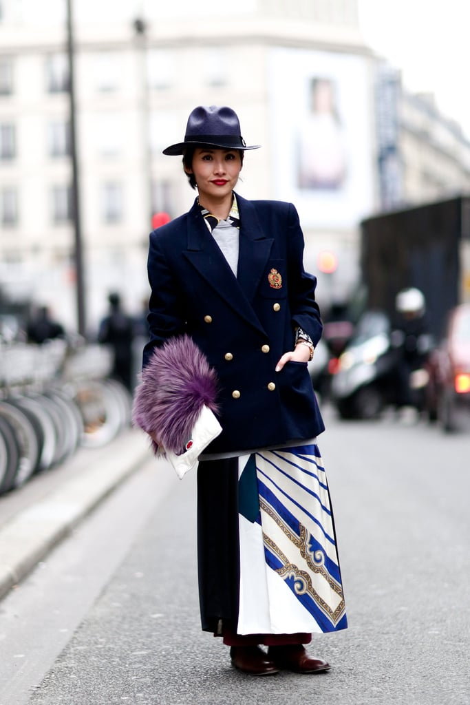 A fashion-conscious play on the boy-meets-girl vibe with a military-style coat on top, printed maxi on bottom, and a plush fur in hand.