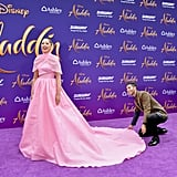 Mena Fixing Naomi's Train on the Purple Carpet