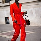 There is nothing that says confidence quite like a bright red power suit.
