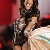 Alessandra Ambrosio flashed a smile on the runway in 2010.