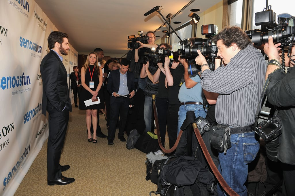 Jake Gyllenhaal struck a pose for photographers before going into the event.