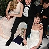 Eddie Redmayne was flanked by his gorgeous co-stars, Amanda Seyfried and Anne Hathaway, at NBC's Golden Globes after party.