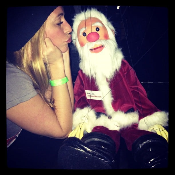 Cat Deeley shared a photo of her giving Santa a kiss. Source: Instagram user CatDeeley