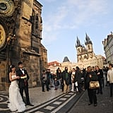 These two become a tourist attraction in Prague's Old Town Square after their wedding.