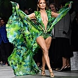 Jennifer Lopez Walking the Versace Runway in a Similar Green Dress During Milan Fashion Week