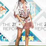 Chanel Iman wearing a fringed Rachel Zoe tunic, MCM bag, and boots at The Zoe Report's Zoeasis party.
