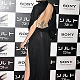 Angelina Jolie displayed her back tattoos at the July 2010 Tokyo premiere of Salt.