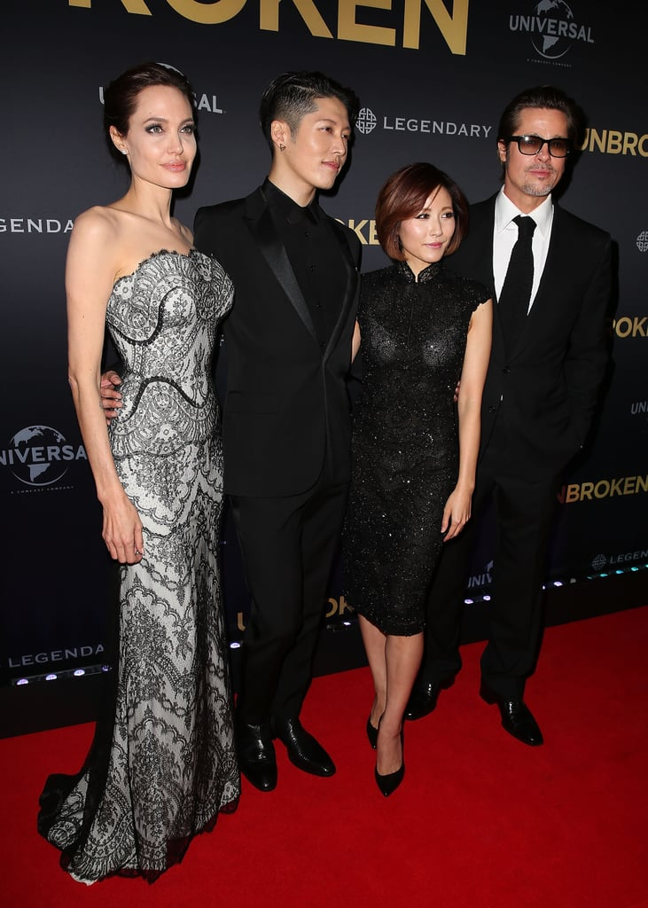 Angelina Jolie and Brad Pitt made their first joint appearance as newlyweds on Monday when they attended the world premiere of Angelina's new film Unbroken, in Sydney, Australia. The pair walked the red carpet with actor Takamasa Ishihara (aka Japanese pop star Miyavi) and his pop star wife, Melody Ishihara. Angie also joined up on the carpet with her movie's star, Jack O'Connell, whom she honoured in LA on Friday at the Hollywood Film Awards.  Although Angelina and Brad got married back in August, they hadn't walked the red carpet together since their big day. The two have been busy filming their latest project, By the Sea, in Europe, although they have been taking breaks for Brad's continued press tour for Fury and Angelina's various promotional obligations for Unbroken, which hits cinemas on Christmas Day. Their schedules came together in Australia, as Brad was already in that part of the world to do press in Japan and Asia.