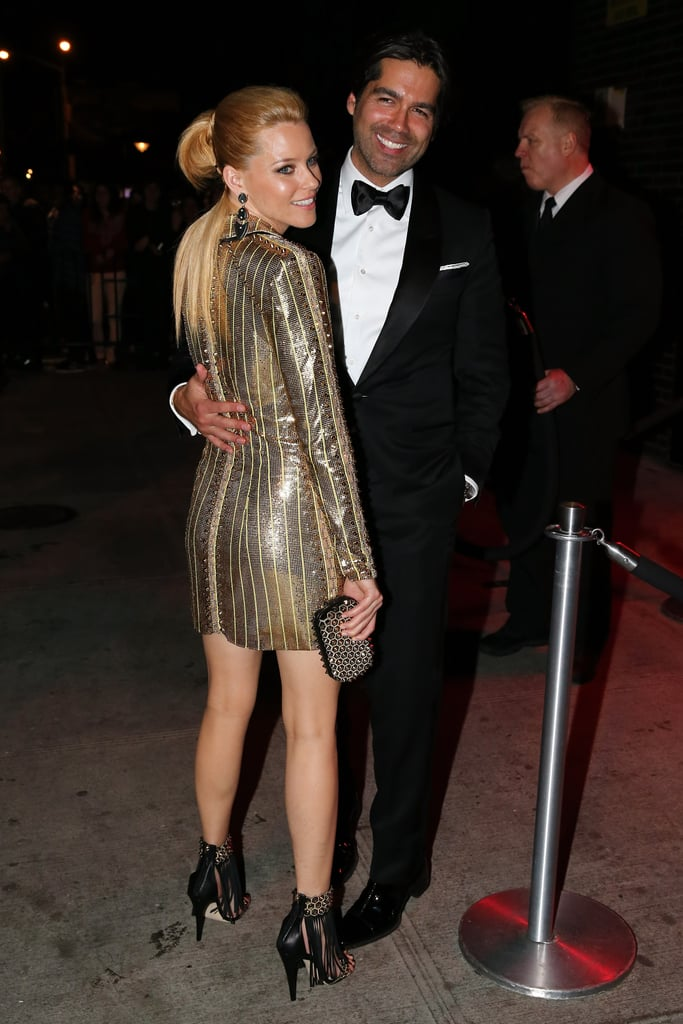Elizabeth Banks and Brian Atwood hugged outside the fete.