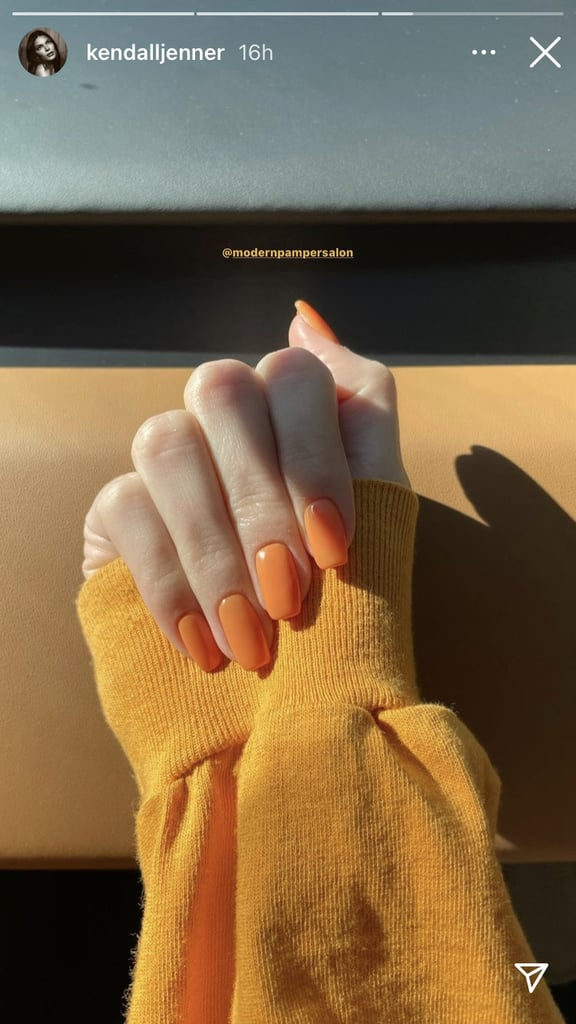Just like a blowout or facial, a fresh manicure has the power to brighten your day. We may still be in the early stages of March but that's not stopping us — or Kendall Jenner, for that matter — from getting a jump-start on the latest nail trends for spring.  After the year we've had, coupled with a long winter (but aren't they all?), it's no wonder that Jenner opted for a warm color like orange for her latest mani at the Modern Pamper Salon in North Hollywood. The SunnyD-inspired shade that she chose is vibrant enough to banish any lingering feelings of the winter blues. Additional celebrity fans of the bright nail polish shade include Selena Gomez, Kylie Jenner, and Cardi B.  For an instant serotonin boost, try the orange nail polish trend for yourself this spring. To get the look at home, some of our favorite colors include Essie's Any-Fin Goes ($9), Orly's Kitsch You Later ($10), and Olive & June's Sweet & Gracious ($8).