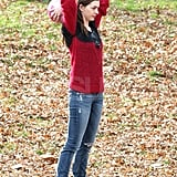 Anne Hathaway threw a ball to her dog.