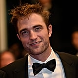 Robert Pattinson flashed a sexy smile at the Good Time screening in 2017.