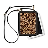 Would you have even guessed this leopard-printed shoulder bag doubled as a tech case? We were certainly fooled. C. Wonder Calf Hair Leather Tech Case ($148)