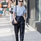 Caroline Issa Was Seen Wearing a Gray Shirt Tucked Into a Pair of High-Waisted Leather Trousers