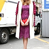 A statement coat, lacy dress, and all of this showgoer's accent pieces shared the same rosy-sweet color palette.