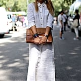 This simple white maxi got a quirky-chic finish with round shades.