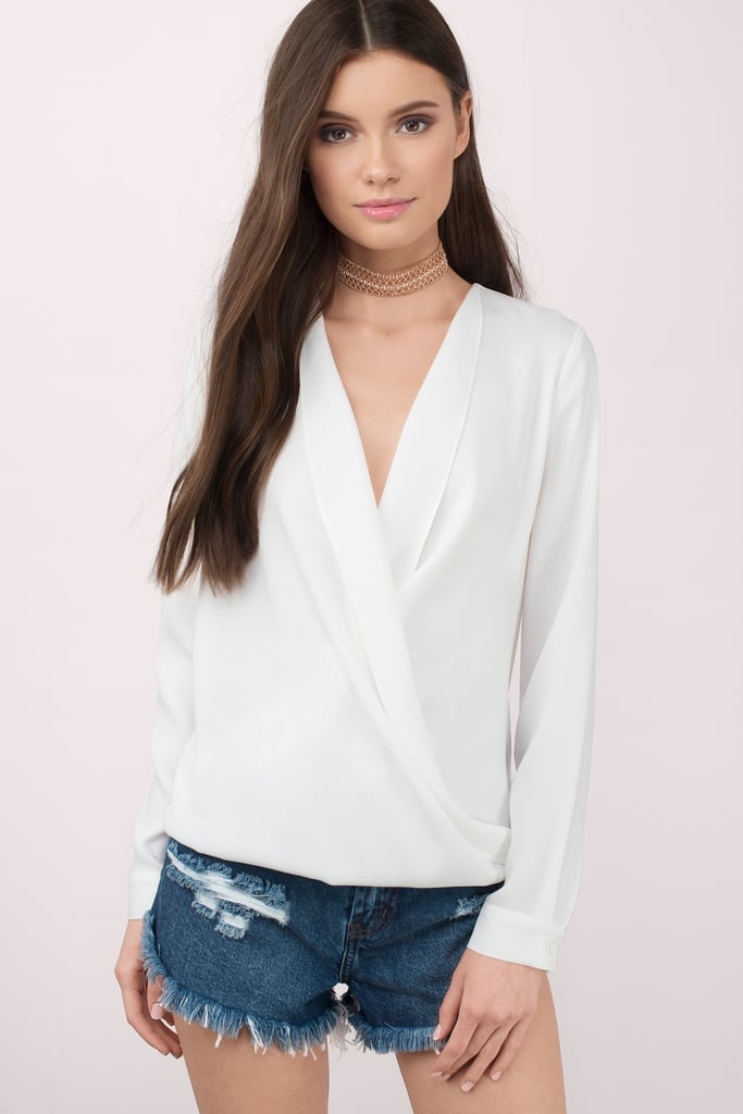 A great top to pair with black slacks or a pair of shorts.  Tobi Loveletter Ivory Chiffon Blouse ($50)
