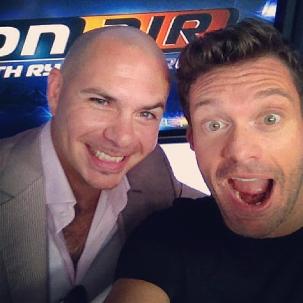 Ryan Seacrest snapped a selfie with Pitbull when the rapper stopped by Ryan's radio show. Source: Instagram user ryanseacrest