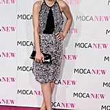 For the MOCA 30th Anniversary Gala in 2009, Carey chose an allover crystal-embellished Prada halter, satin black pumps, and a patent leather letter clutch.
