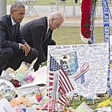 Signed posters, flowers, and flags make up the memorial to the victims of the Orlando shooting.