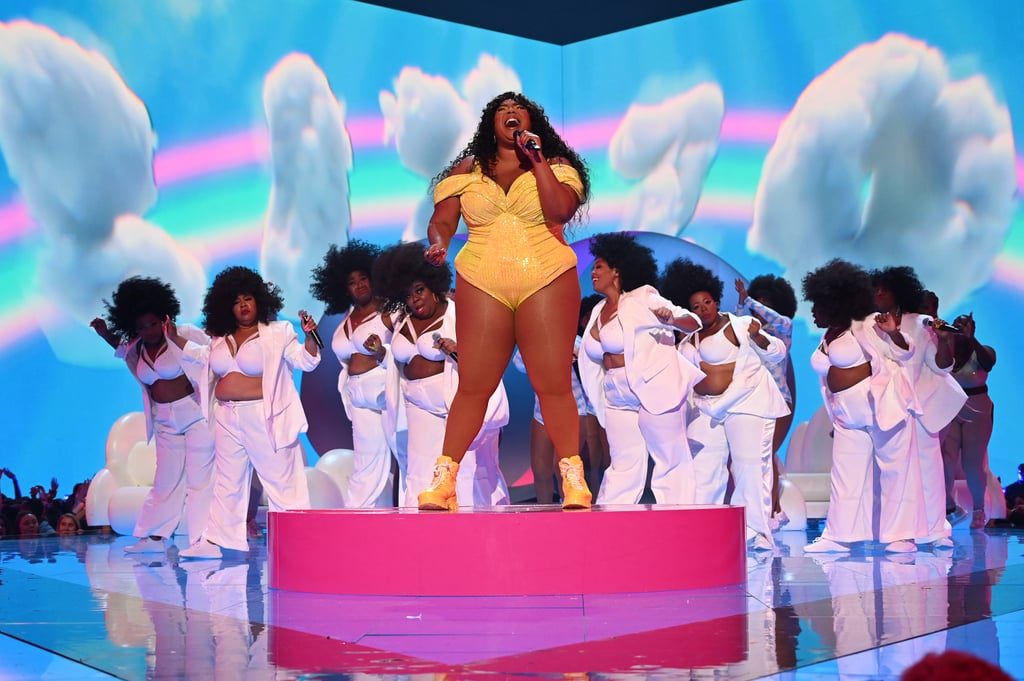 "Lizzo manages to inject a good dose of cheer in all her performances and the 2019 MTV VMAs was no different! The 31-year-old singer took the stage to perform a rousing medley of her hit singles ""Good as Hell"" and ""Truth Hurts,"" complete with a giant butt balloon and cloud props all over the stage. Though she started her performance with the clapback anthem about washing ain't-good-for-nothing men out your hair, she smoothly transitioned into ""Good as Hell,"" enforcing the song's self-love message with an outfit change into a bright yellow bodysuit and dancers wearing cloud-print bodysuits as they crooned along with her.  ""Let me talk to y'all for a second,"" she said, stepping onto a platform during the song's breakdown. ""I'm tired of the bullsh*t and I don't have to know your story to know that you're tired of the bullsh*t too. It's so hard trying to love yourself in a world that doesn't love you back, am I right? So I want to take this opportunity right now to just feel good as hell! Because you deserve to feel good as hell!"" Preach, Sister Lizzo! It's unsurprising that Lizzo's performance had the entire audience on their feet — shoot, there were probably viewers at home on their feet as well! We'll definitely be coming back to this performance whenever we need cheering up, but for now keep scrolling to check it out, and get an eyeful of all the gorgeous shots from her performance too.      Related:                                                                                                           Lizzo Is Feeling Herself At the MTV VMAs, and We Wouldn't Want It Any Other Way"