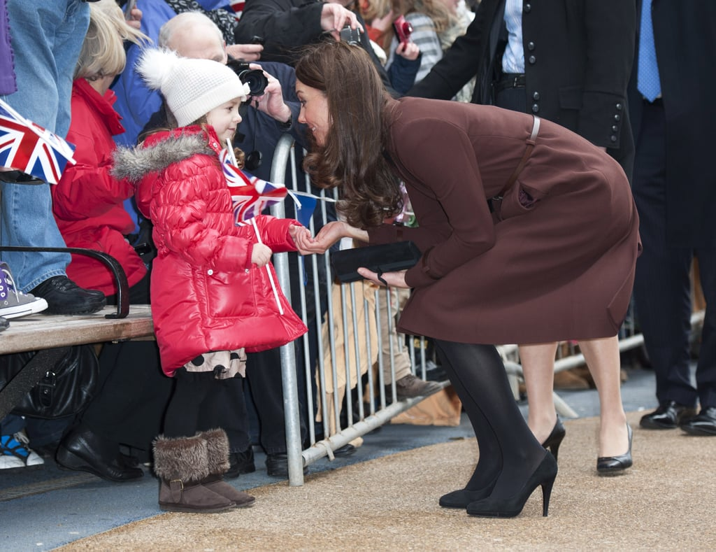 Kate Middleton bent down to greet a little girl during a solo trip to the Alder Hey Children's Hospital in Liverpool, England, back in February 2012.