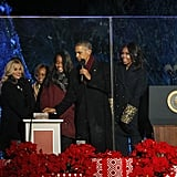 You could spot the FLOTUS's sleeves from a mile away as she took the stage with her family and Reese Witherspoon.