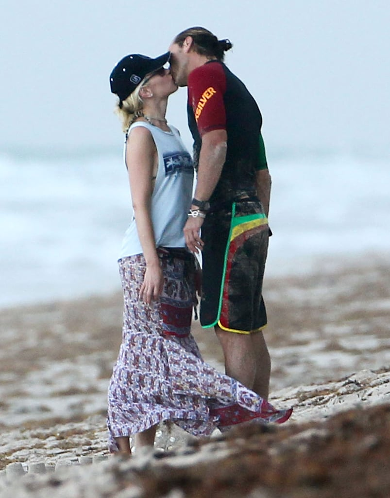 The couple went in for a kiss in Palm Beach, FL, in August 2012.