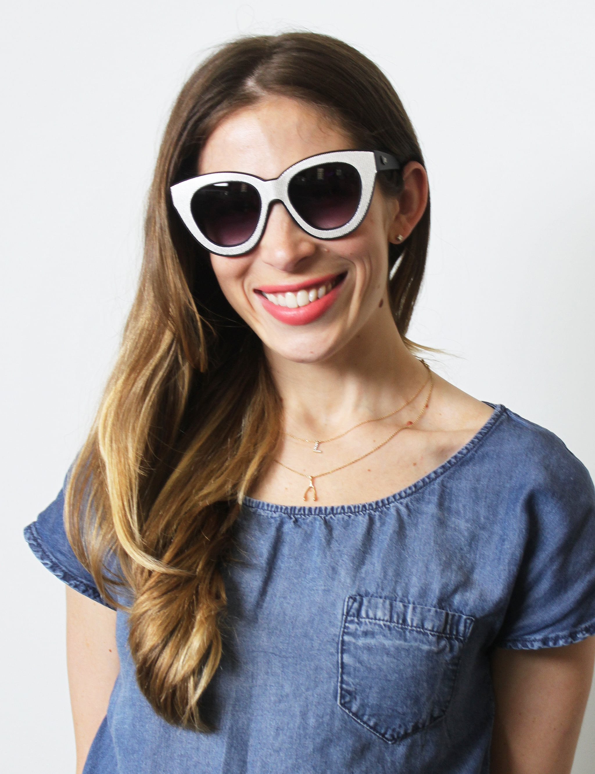 There's absolutely nothing subtle about these black-and-white Nasty Gal frames (similar style: Nasty Gal CRAP Eyewear Diamond Brunch Shades, $62). A nude lip would be too demure, but a hot pink or bold red might feel too over the top. Meet in the middle with a matte coral like Givenchy Le Rouge in Croisière Coral (similar style: Givenchy Le Rouge in Corail Décolleté, $36).