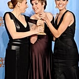 The cast of Girls posed with their award in the press room.
