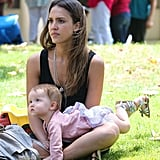 For an afternoon playdate in a Beverly Hills park, Haven wore a floral dress, a pink sweater, and silver sandals.