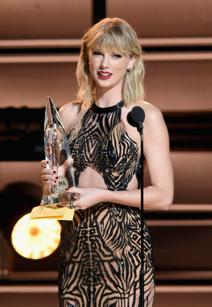 "Taylor Swift returned to country music for one night as she attended the CMA Awards on Wednesday night. The former country star stunned in a black cutout dress as she took to the stage to present Garth Brooks with the entertainer of the year award, an honor she's received twice. As the CMAs celebrate their 50th anniversary, this year also holds some special significance to Taylor as her self-titled debut album turns 10 years old! My, how far she's come since crooning ""Tim McGraw"" on her studded guitar.      Related:                                                                Taylor Swift Sings Calvin Harris's Song During Her First Performance in Nearly a Year                                                                   A Comprehensive Guide to Who Taylor Swift's Songs Are About                                                                   13 Taylor Swift Facts Only a True Swiftie Would Know"