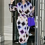 Decked out in a Fendi coat with a brilliant violet-hued Fendi bag in tow.
