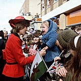 A young child looked quite happy to meet Diana during her visit to Rhyl, Wales, in October 1981.