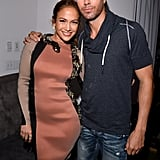 Enrique Iglesias had his arm around Jennifer Lopez at a press conference to announce their Mega tour.