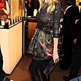 Claudia Schiffer was all smiles in a mini dress and black boots.