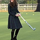 Kate Middleton showed off her field hockey skills in a plaid suit and heels during a visit to the University of St. Andrews in November 2012.