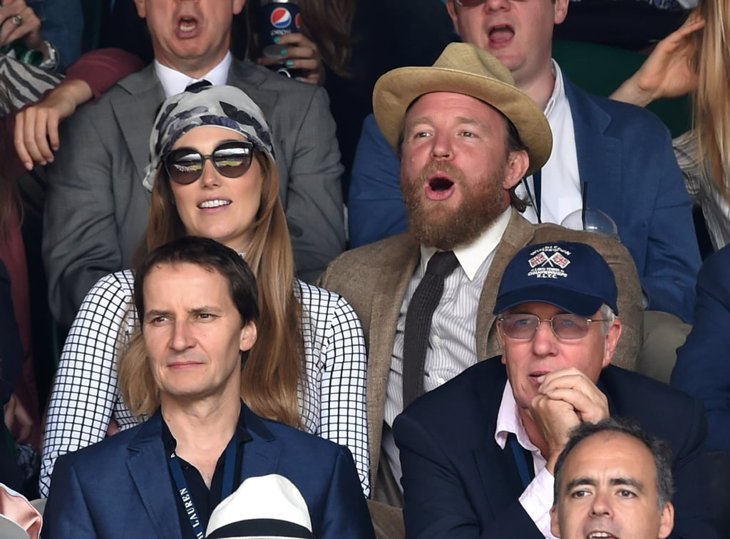 Guy Ritchie sported a beard as he watched a match with fiancée Jacqui Ainsley.
