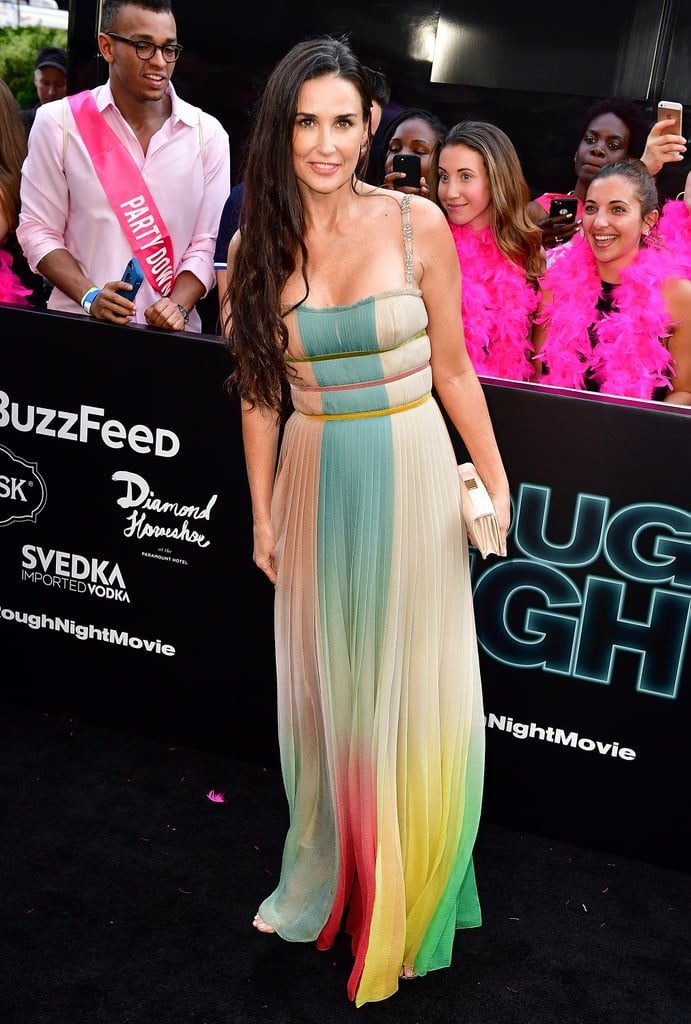 Demi Moore has been turning heads on the red carpet for years, and her latest look did exactly that and so much more. The 54-year-old actress stepped out in New York City for the premiere of her new movie Rough Night wearing a stunning multicolored Christian Dior silk chiffon gown.  Demi's pastel dress was pulled together with contrasting midriff straps and featured the designer's name embroidered on the shoulder straps. The bottom of the dress brightened up the whole carpet, beaming gorgeous red, blue, green, yellow, and purple colors. Demi paired the rainbow dress with a Dior tarot card clutch and Giuseppe Zanotti Silver Darcie sandals. Keep reading to see photos of Demi's gorgeous bright look and shop similar styles below.