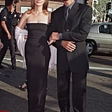 Julia completed a sexy, strapless black dress with a ladylike pink shawl at the premiere of Runaway Bride in 1999.