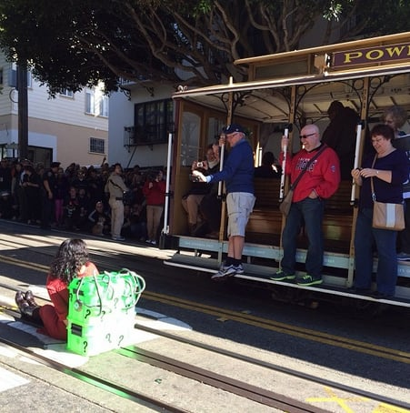 A woman played the damsel in distress while people watched from a cable car. Source: Instagram user editag