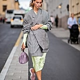 Style a checkered one over a pastel-hued silk dress for a high-low look.