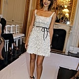 Jessica Alba wore a flirty white Valentino frock at Valentino's Haute Couture show in Paris.