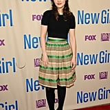 Want to try out the look without showing your entire midriff? Take a cue from Zooey Deschanel, who went for a high-waisted skirt that left just a sliver of skin.