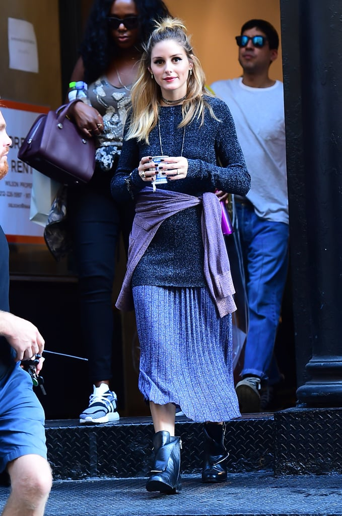 A sparkly knit set sounds a little much, until you give it the Olivia Palermo treatment with plenty of layered chokers, a loose, messy bun, and the addition of a knotted tee around the waist. Boots instead of heels also help to give the ensemble a much more approachable, everyday feel that's entirely wearable and modern.