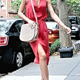 Miranda Kerr showed skin in a red dress.